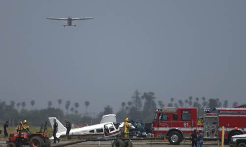 Warrior crash at Oxnard, with our Skylane departing in the background