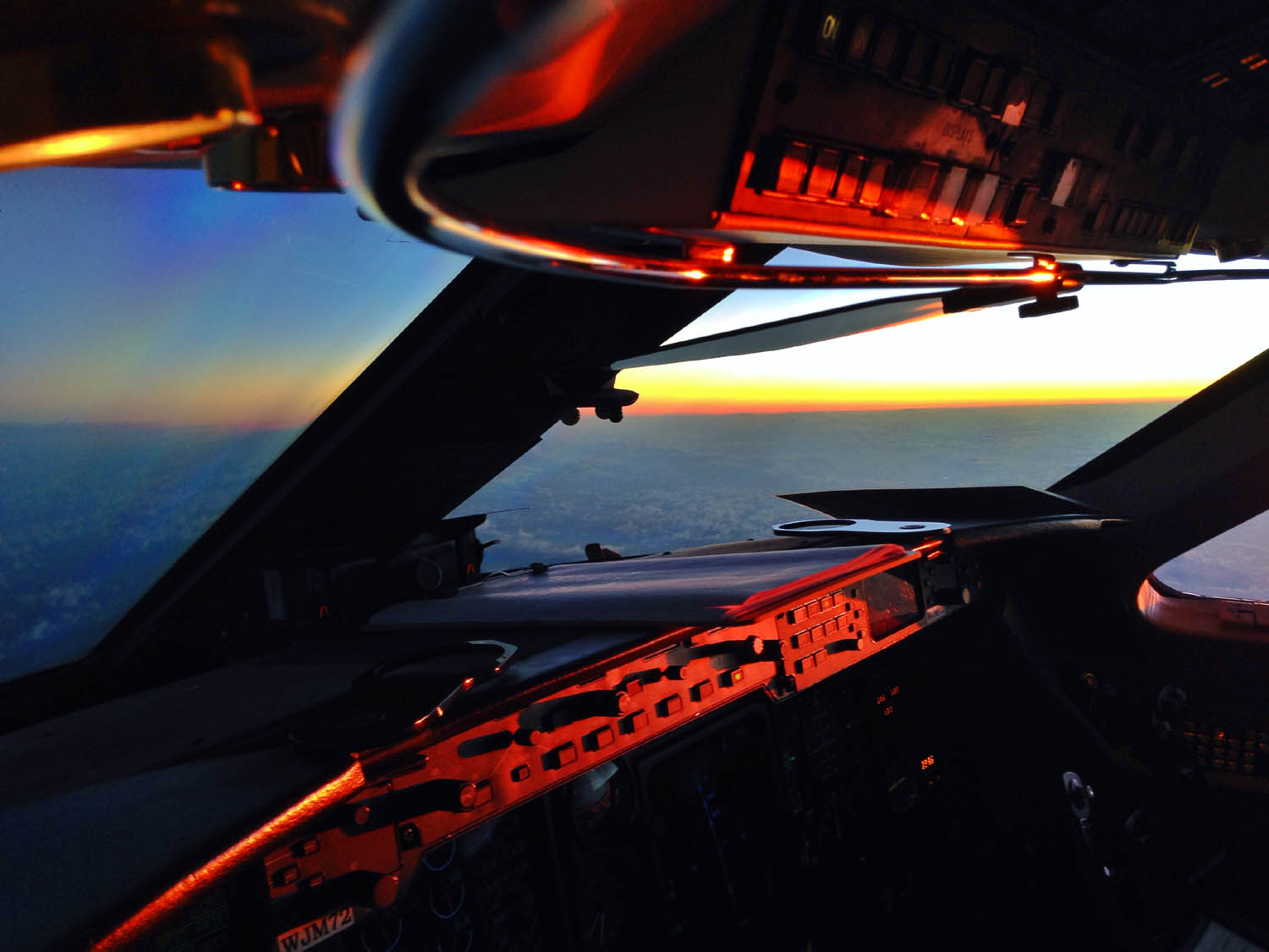Those red-eyes can be painfully long.  It's always worth it when a beautiful sunrise casts that reddish glow across the cockpit.