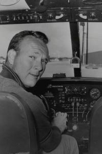 Arnold Palmer at the controls of his Aero Commander twin.