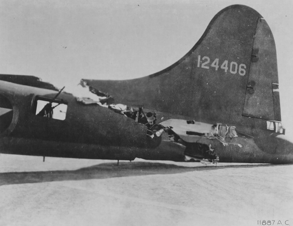 Mid-airs are nothing new.  This B-17 collided with a German fighter over Tunisia in 1943.