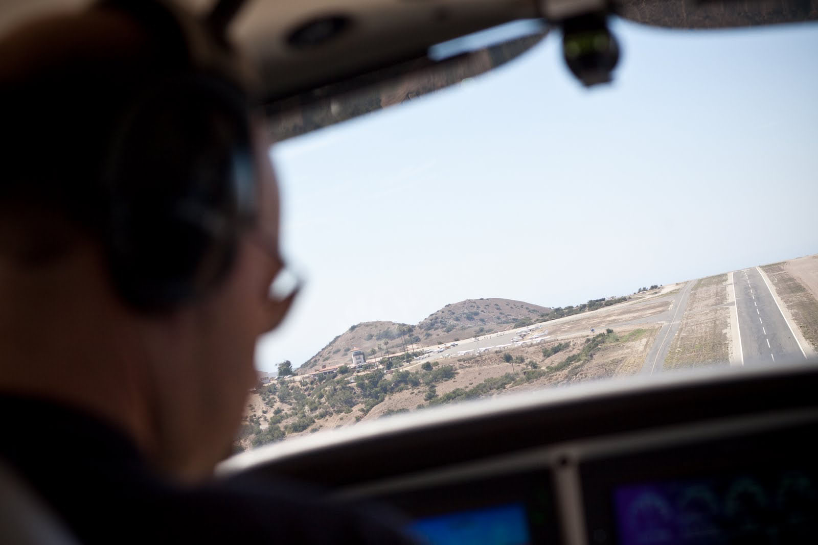 On final approach to runway 22.  The airport sits on top of a bluff, with steep drop-offs at both ends.