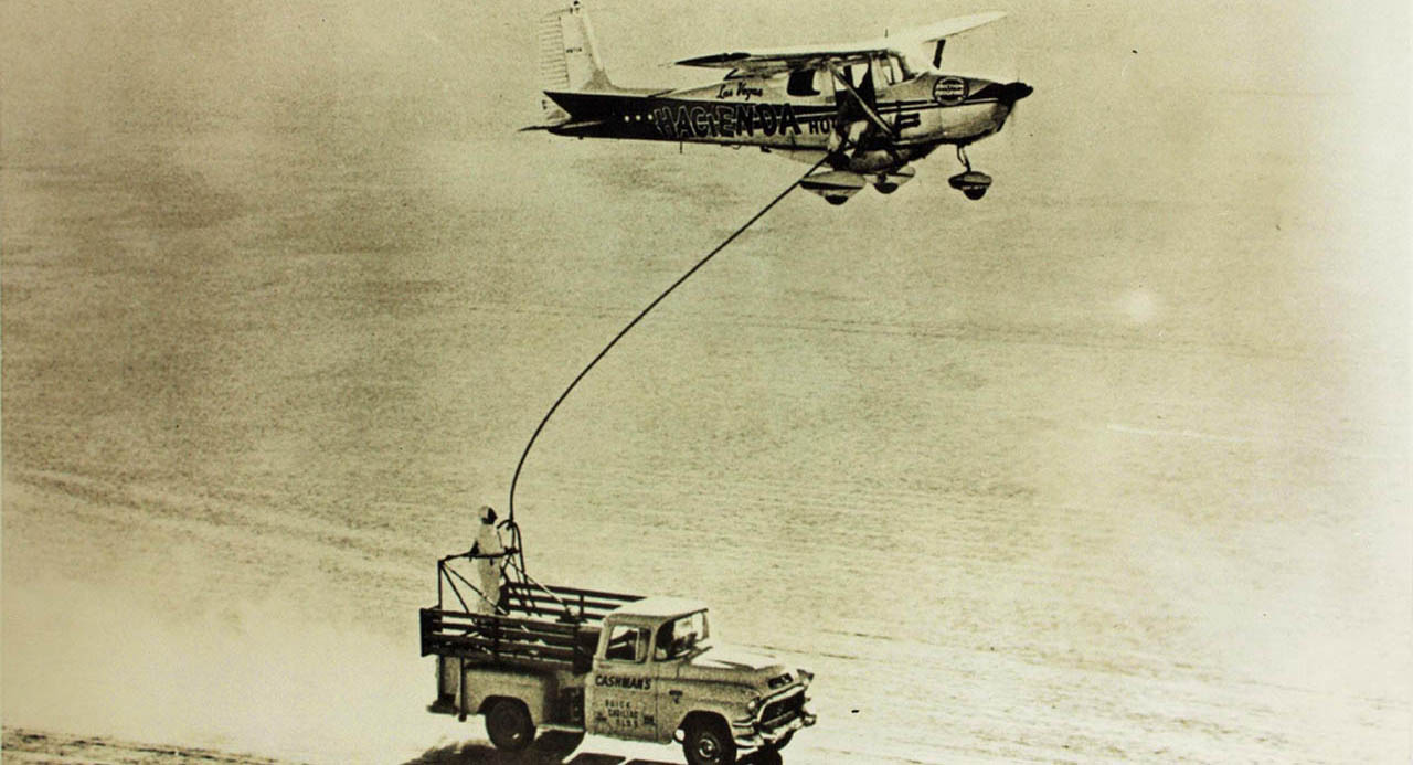 Refueling was done by flying in formation with a support vehicle.  The aircraft was equipped with a belly tank, but even so, they refueled 128 times in total.
