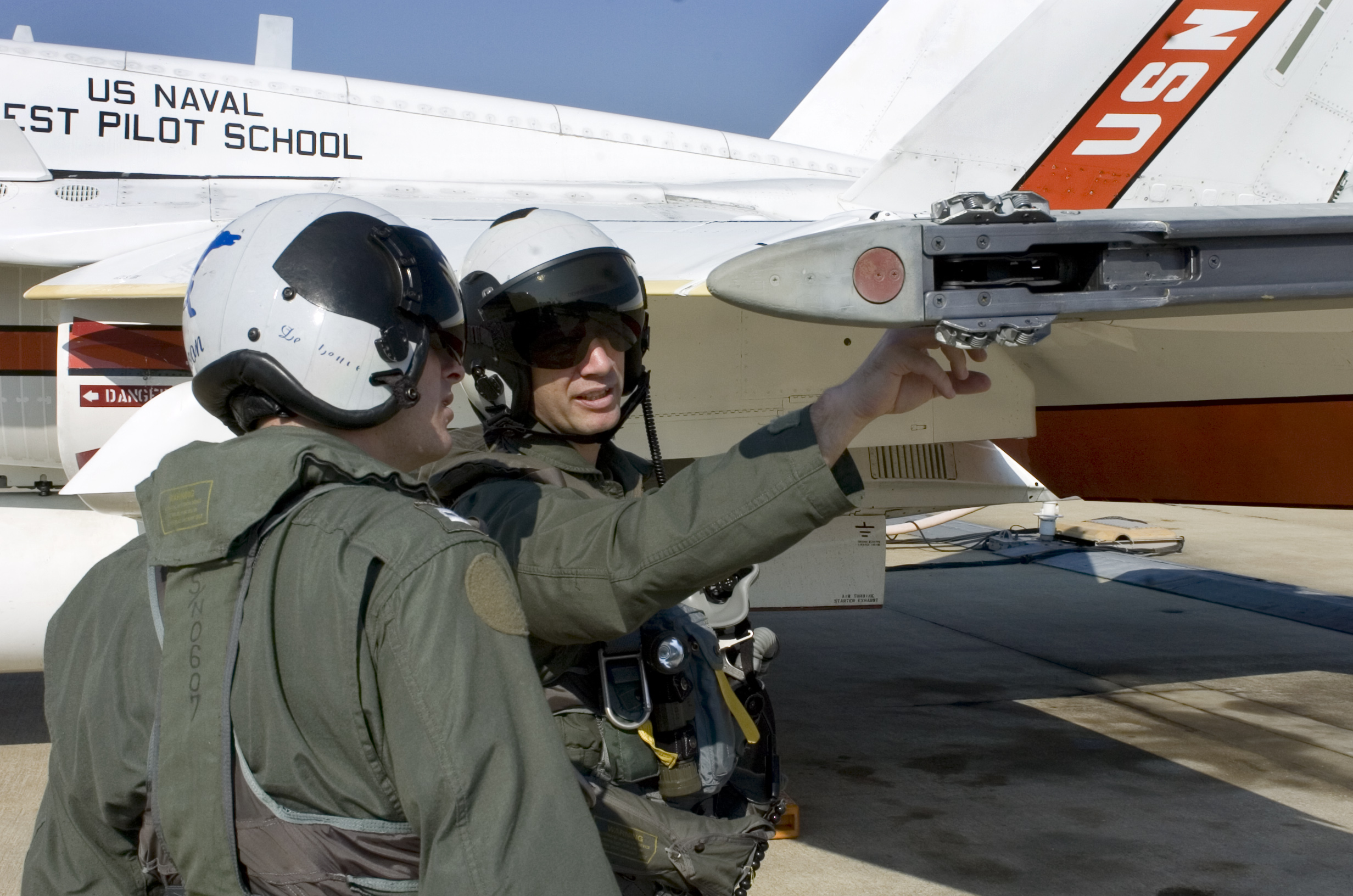 Student and instructor preflight an F-18 at Patuxent River