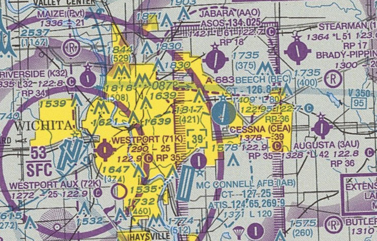McConnell AFB, the flight's destination, is the Class D airport at the bottom of the chart, about nine miles south of the non-towered Jabara Airport.